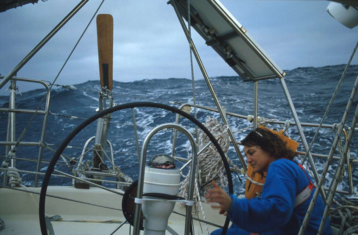 Adjusting the vane steering equipment in the Indian Ocean. ANMM Collection, reproduced courtesy Kay Cottee.