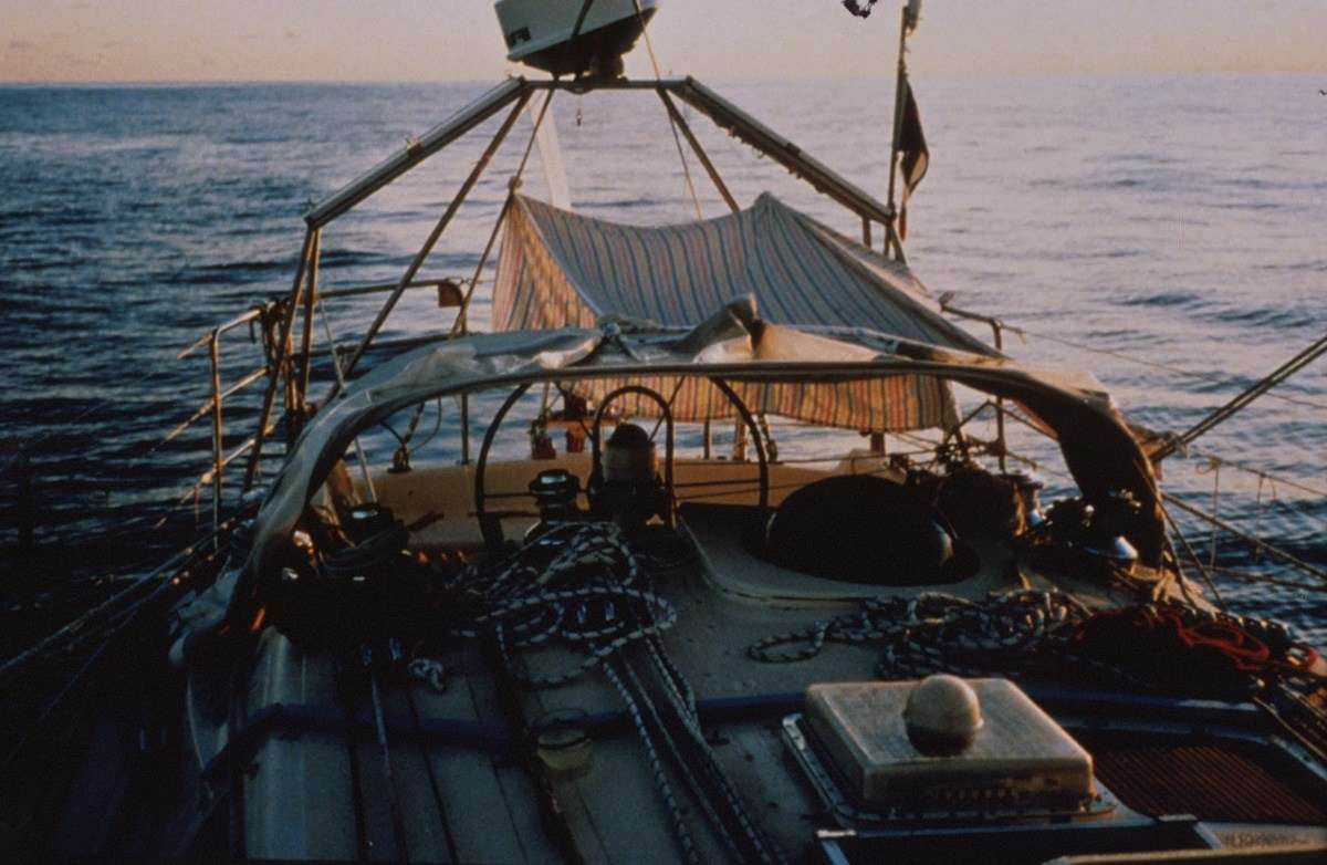 Up mast, winch service. Becalmed in the Indian ocean using a bedsheet for a cover. ANMM Collection, reproduced courtesy Kay Cottee.