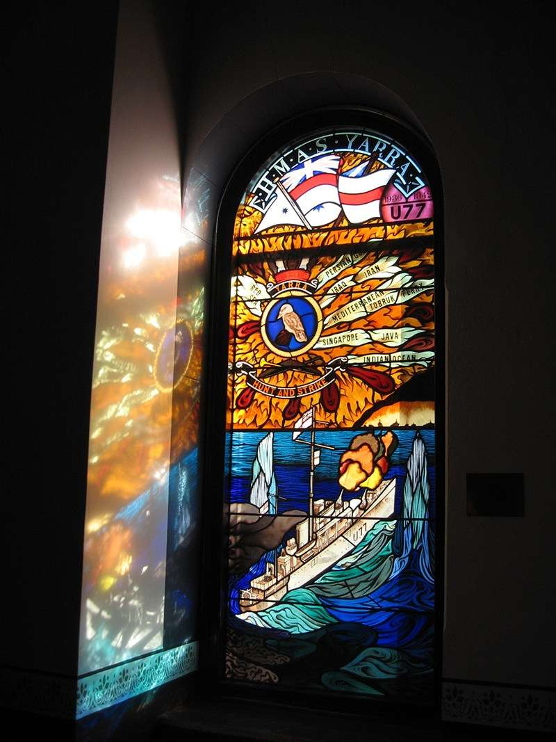 Stained-glass window in the Naval Chapel of Sydney's Garden Island Naval Base depicting HMAS Yarra. Image: Jeffrey Mellefont.