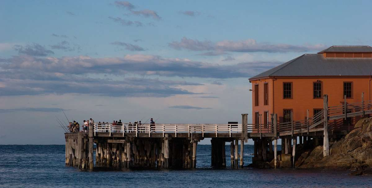 Tathra wharf. Image: By Griffwiki - Own work, CC BY-SA 3.0, https://commons.wikimedia.org/w/index.php?curid=6380419 .