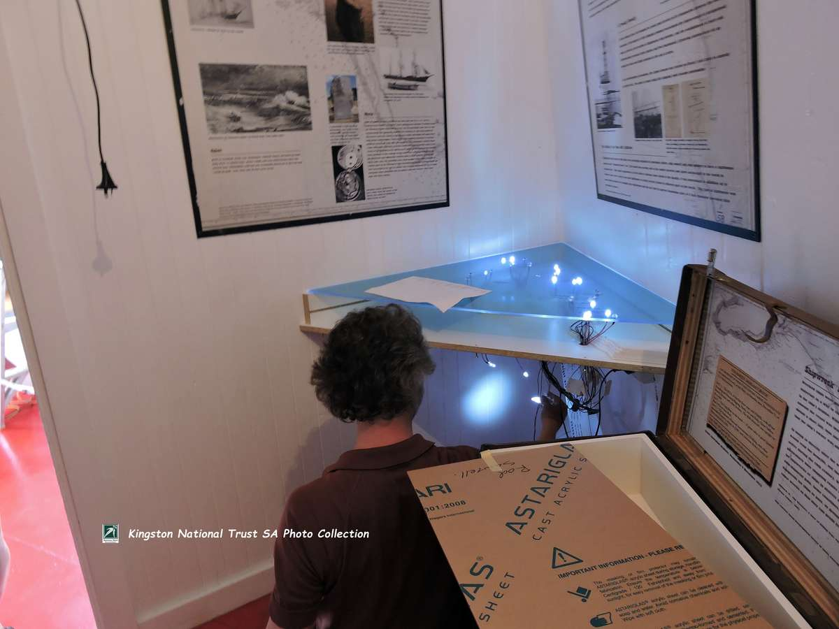 Curator, Richard Browning, working with the installation of the interactive Shipwreck Map. (Photo: May McIntosh)