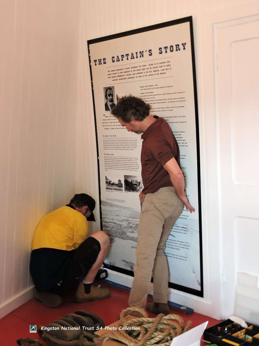 Richard is with the first of the interpretive panels, installing it on Cape Jaffa Lighthouse's sloping walls. (Photo: May McIntosh)