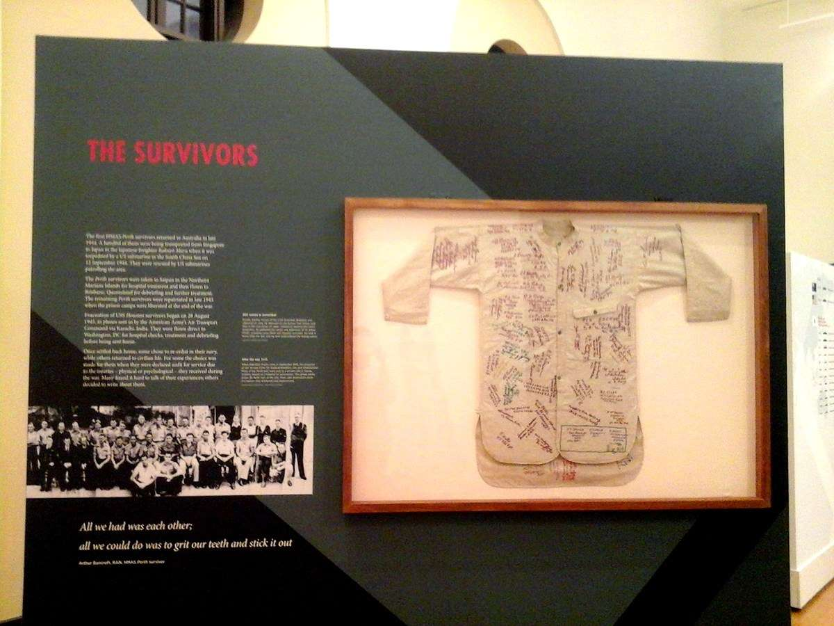 Story 6 talks about the survivors returning home after the war. The framed calico undershirt has some 200 POW signatures and addresses. It is on loan from the Australian War Memorial. Image: Lindsey Shaw / ANMM.