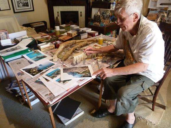 A lot of research went into designing the diorama. Here Geoff paints the rocky cliffs of the bay of Naples from photo references. Image: Roger Scott.