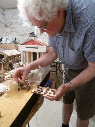 Roger Scott install figures and props. Image: Geoff Barnes.