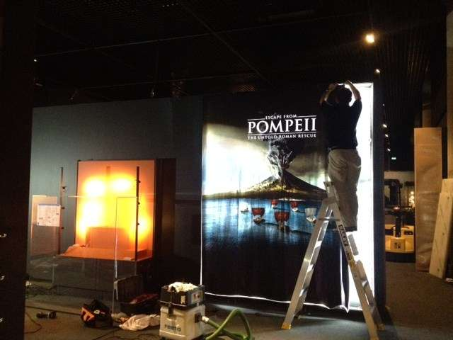 The lightbox at the exhibition entry being installed