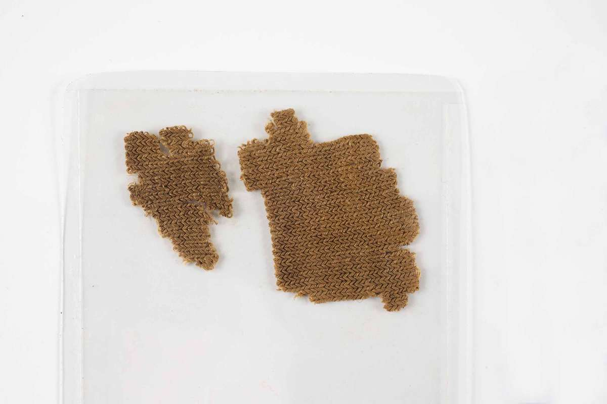 Two fragments of knitted fabric excavated from the wreck of the Batavia. ANMM Collection Transferred from Australian Netherlands Committee on Old Dutch Shipwrecks