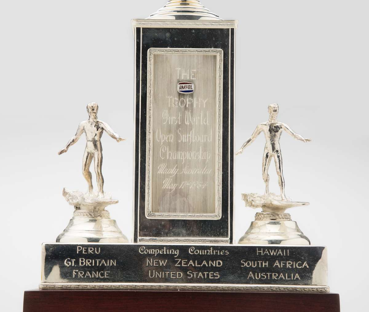 Ampol trophy for the first world open surfboard championship, Manly, Australia, maker unknown, silver plated base metal. Men's final won by Bernard 'Midget' Farrelly 17 May 1964. Gift from Bev Farrelly and family in memory of Bernard 'Midget' Farrelly. ANMM Collection 00054955.
