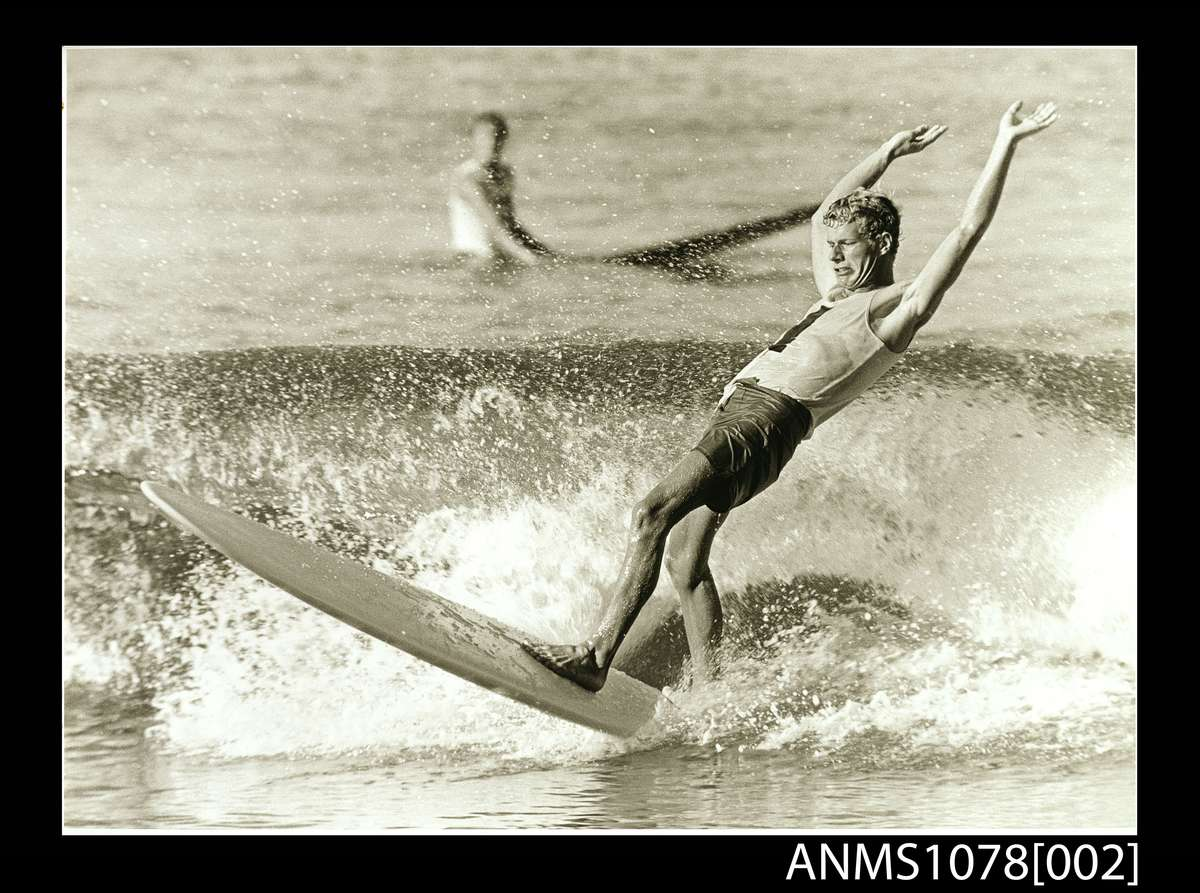 Jack Eden, Bernard 'Midget' Farrelly in action at the first world open surfboard championships Manly, May 1964. ANMM Collection ANMS1078[002] Gift from Jack and Dawn Eden.
