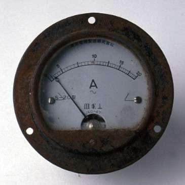 Amp meter gauge believed to be from destroyed Japanese midget submarine. ANMM Collection 00019506.