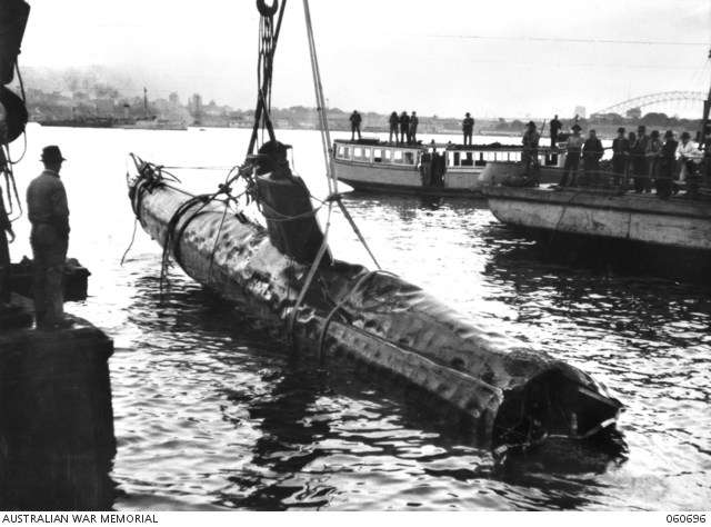"The wreck of M14 being recovered. Image: <a href=""https://www.awm.gov.au/collection/C48694"">Australian War Memorial</a>, via Wikimedia."