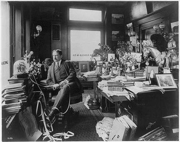 Thomas W. Lawson in his office, surrounded by the fresh flowers and books he loved. Image courtesy of the Library of Congress.