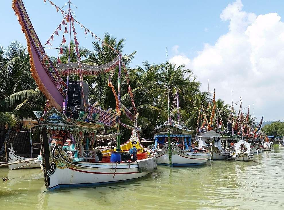 Pride and prosperity are evident in the day-to-day, working livery of fishing boats called perahu pursen moored along the river bank in Pasongsongan, Madura.