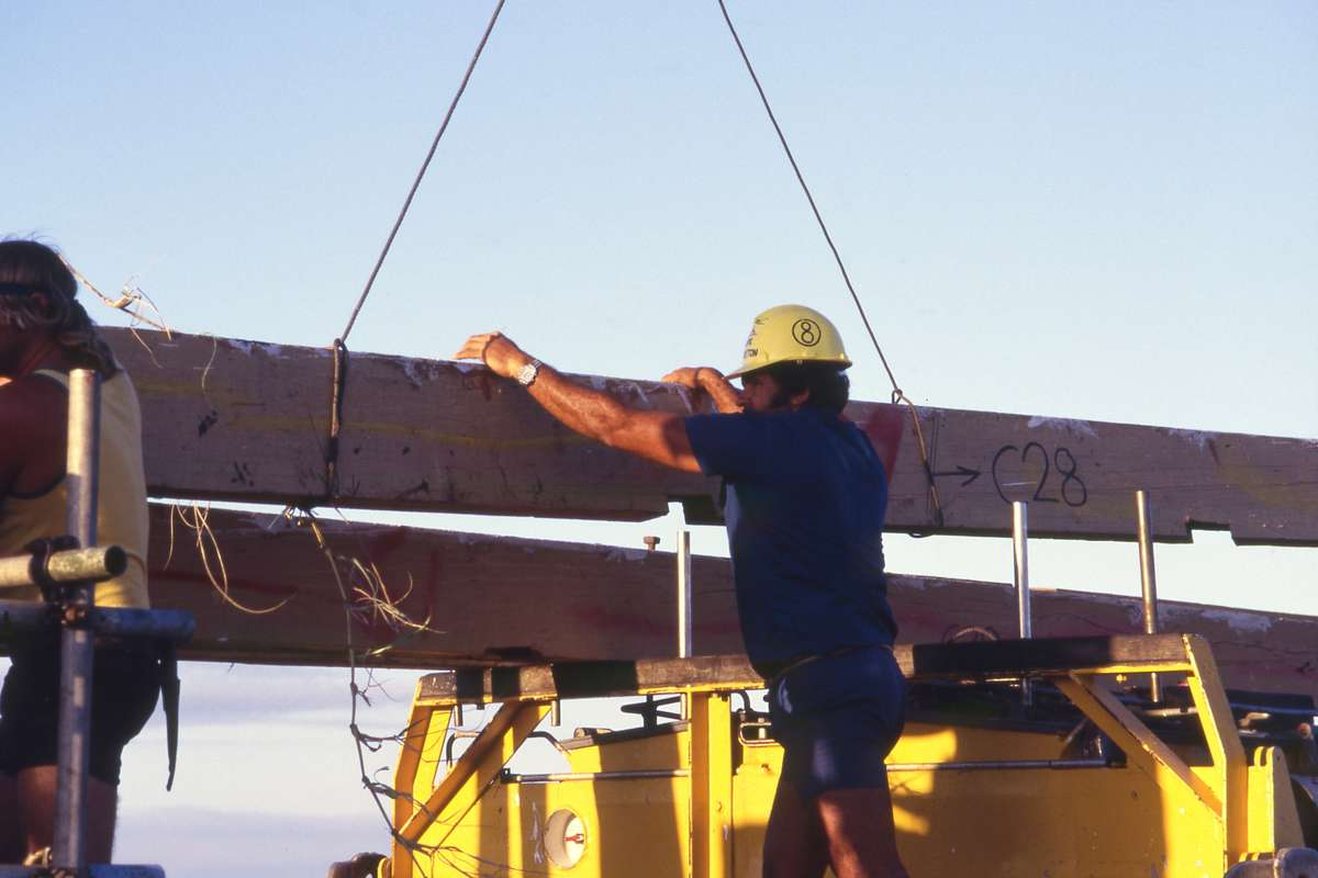 Department of Transport worker stabilising part of the lighthouse