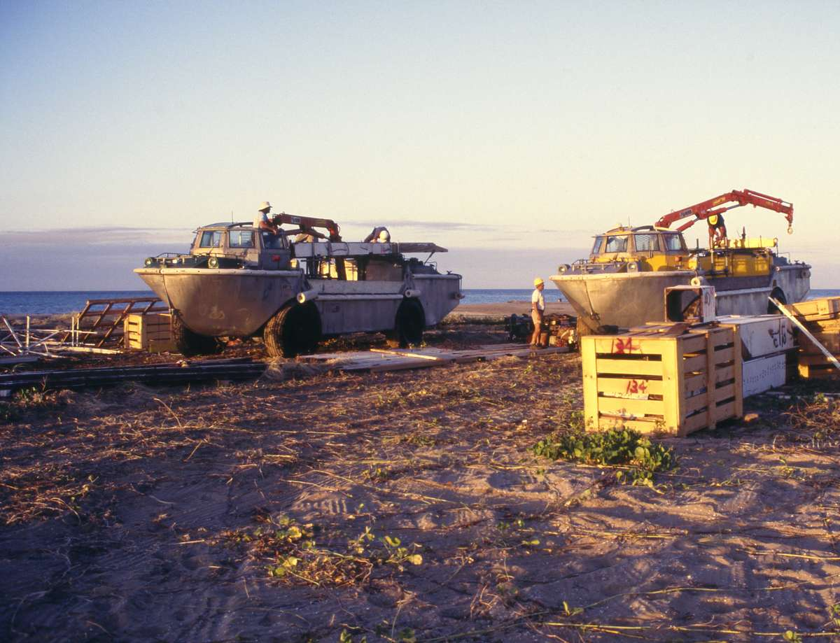 Two LARCs being loaded with lighthouse timbers on the beach at sunrise 1987. Credit: Jennifer Game