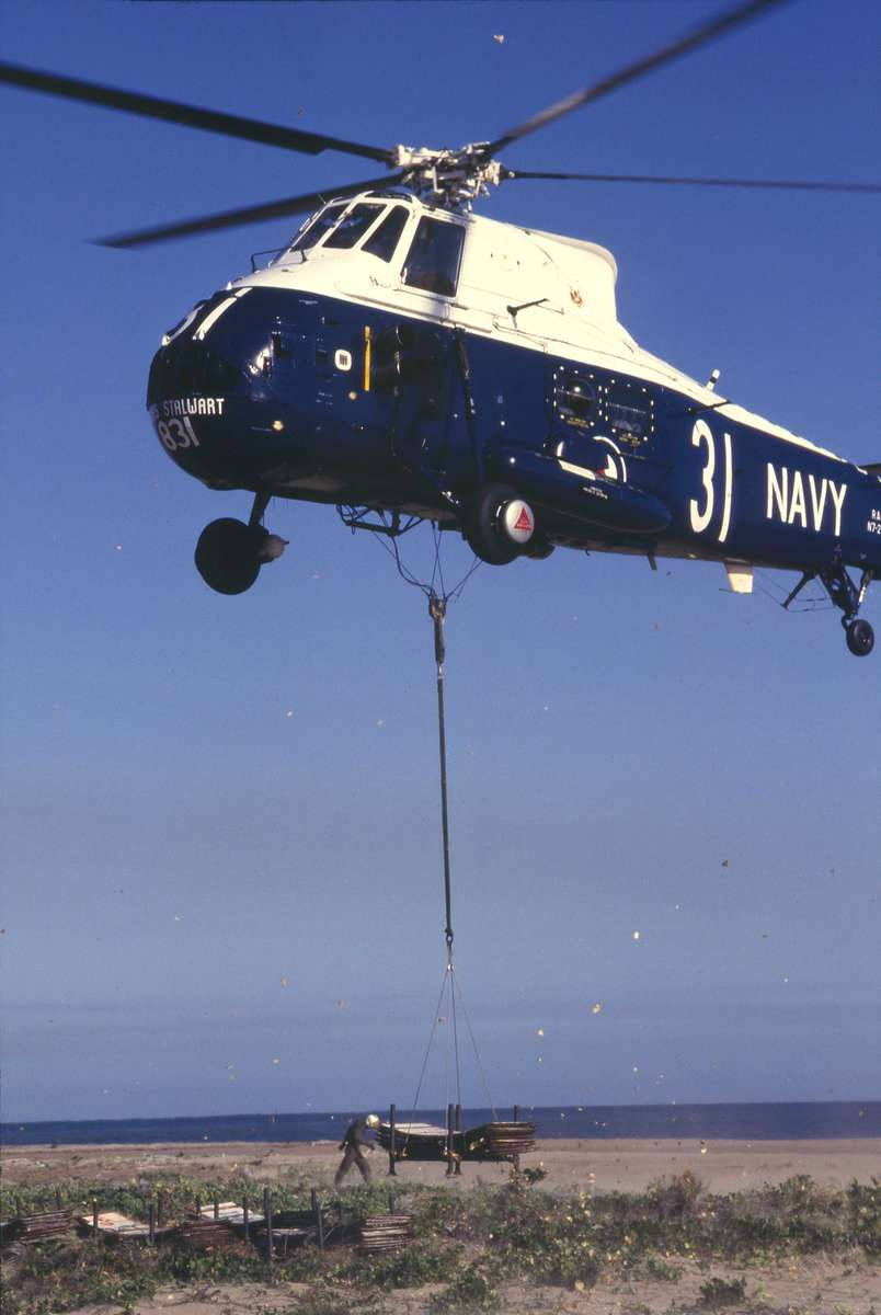 Westland Wessex helicopter lifts a payload of lighthouse cladding for transportation to HMAS Stalwart, 1987. Credit: Jennifer Game.