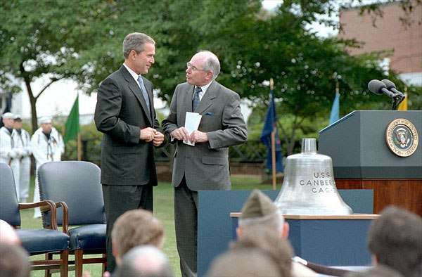 President George W Bush presented the USS Canberra bell to Australian Prime Minister John Howard at Washington Navy Yard on 10 September 2001 to commemorate 50 years of the ANZUS military alliance. Image: White House photo by Tina Hager.
