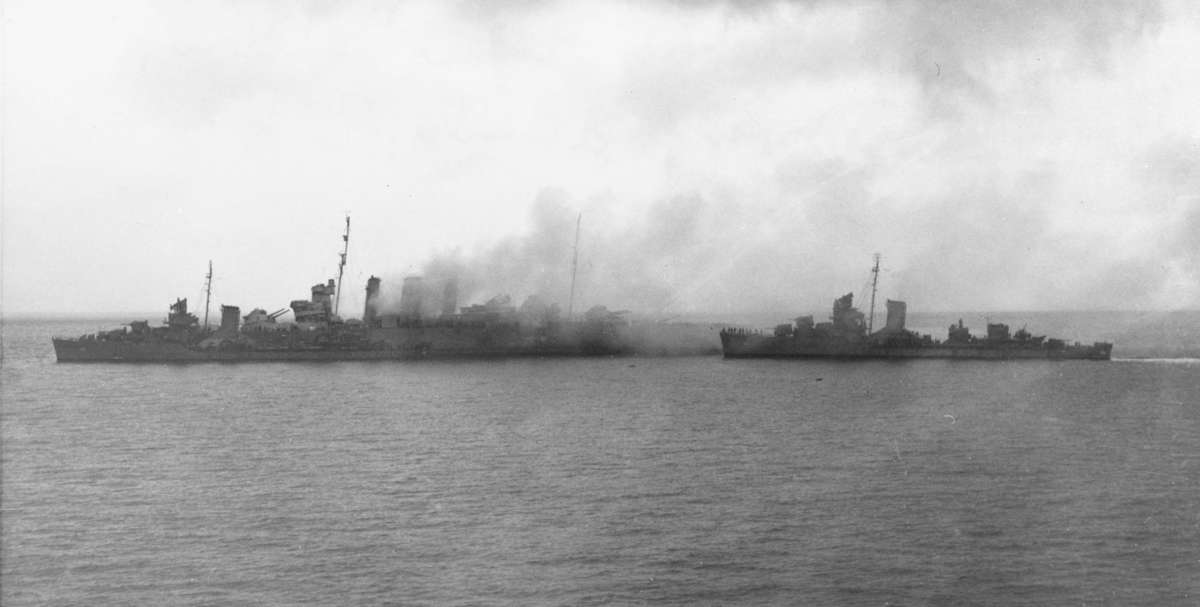 USS Blue on HMAS <em>Canberra's</em> port bow and USS <em>Patterson</em> approaching to rescue survivors on 9th August 1942. Image: US Naval History and Heritage Command.