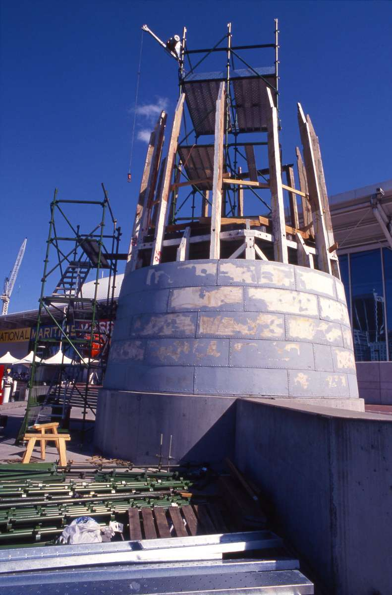 Riveting the iron cladding to the lighthouse exterior, 30 August 1993. Image: ANMM.