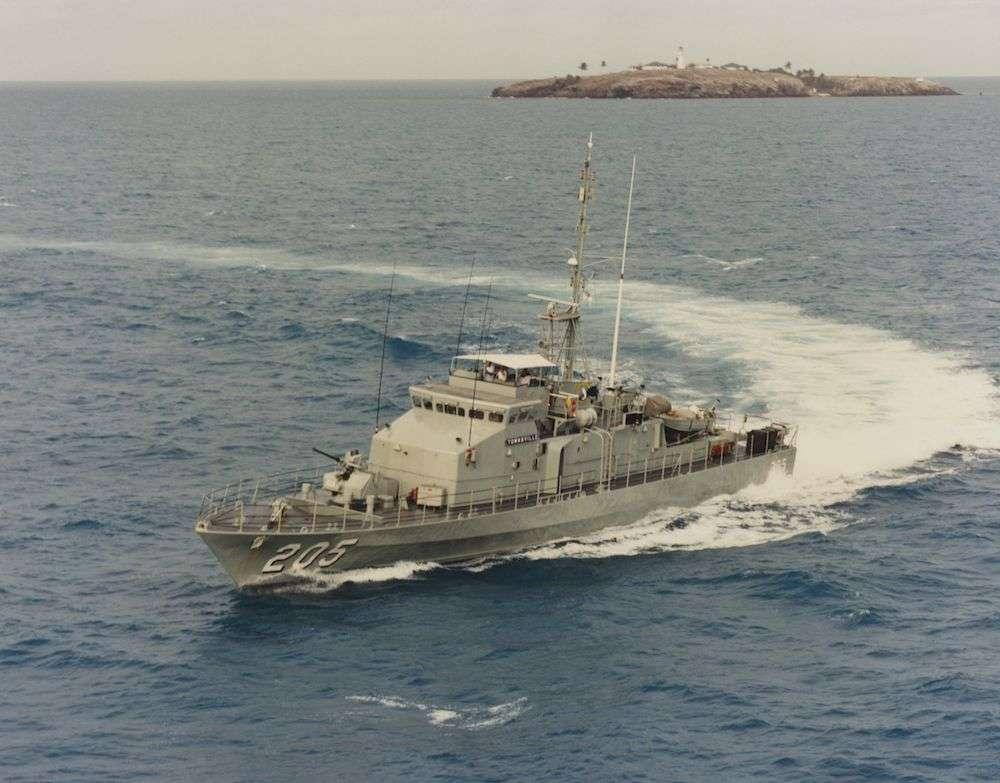 HMAS <em>Townsville</em> in action. Image: HMAS Townsville database / Royal Australian Navy.