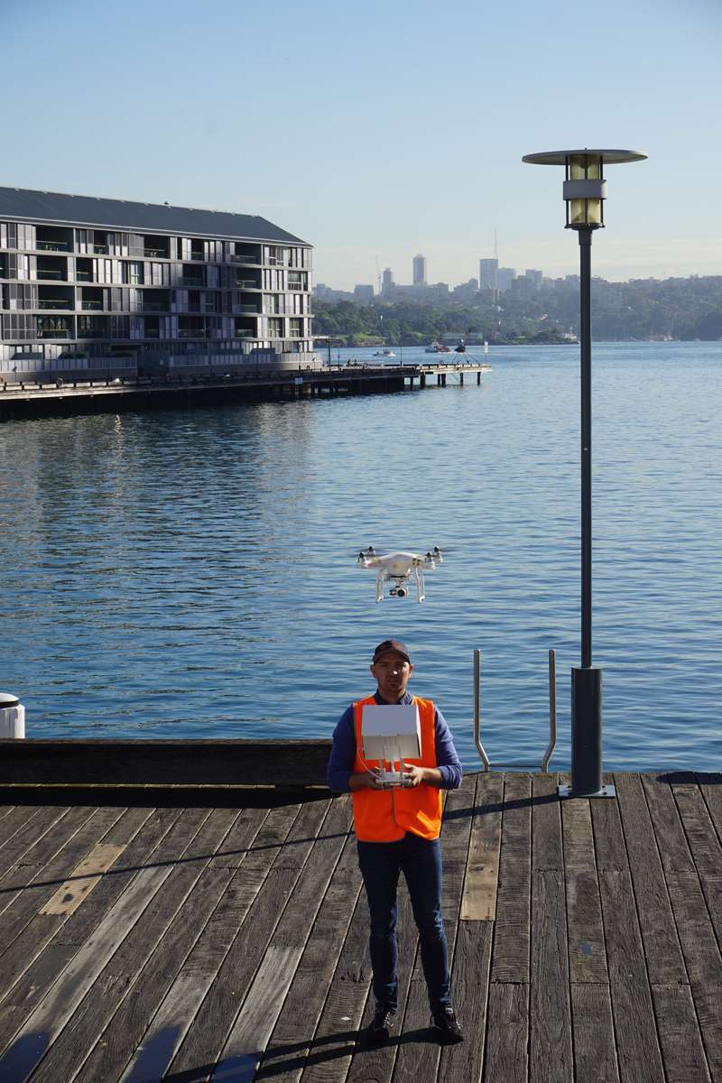 UAV Pilot Simon Wojcik preparing to photograph Cape Bowling Green Lighthouse. Image: ANMM.
