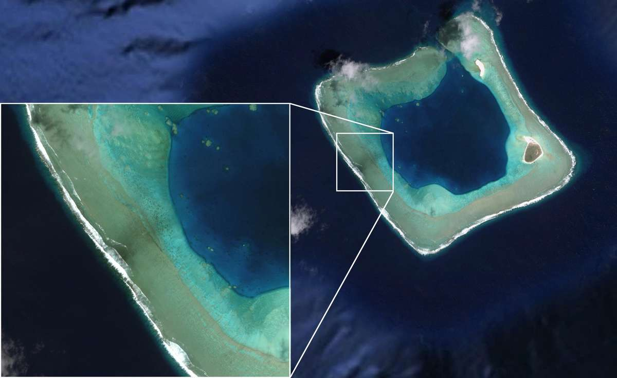 Satellite image of Rose Atoll (American Samoa), showing 'black reefs' generated by the wreck of the modern fishing vessel Jin Shiang Fa. Image: Google Earth/DigitalGlobe/NOAA.