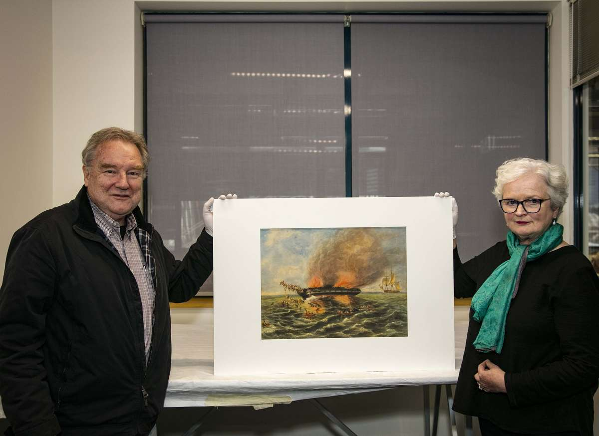 Cousins John Grant and Catherine Bell with the Samuel Elyard watercolour at the museum, 2017. Image: Andrew Frolows/ANMM.