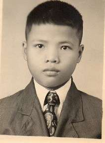 Albert's passport photo, when he first arrived in Australia aged 13. Image courtesy Millie Soo.