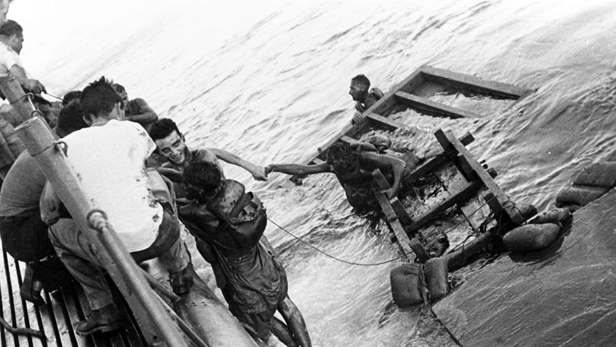 In September 1944, US submarines torpedoed a convoy of Japanese cargo transports in the South China Sea – unaware that POWs were aboard, including Perth men. Left to die by the Japanese, prisoners clung desperately to wooden rafts. US submarines Pampanito, Sealion, Barb and Queenfish rescued 159 oil-sodden, exhausted, starved and dehydrated Allied POWs, sharing their clothes, food and bunks with them. Image: US Naval History and Heritage Command.