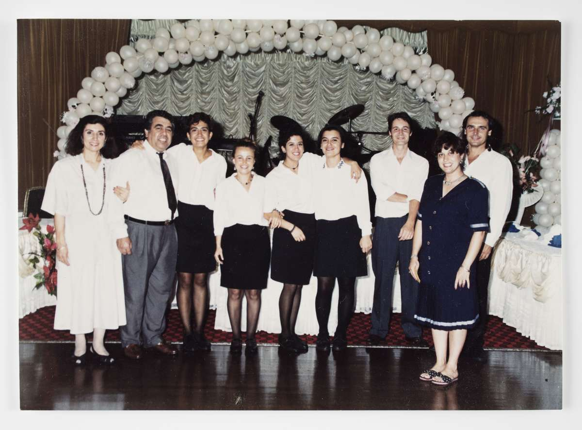 The Adasal family with staff at their Bosphorus Function Centre in Auburn, 1990s. Şükran, Halit and Hale are at far left, with Funda in the centre. Reproduced courtesy Hale Adasal