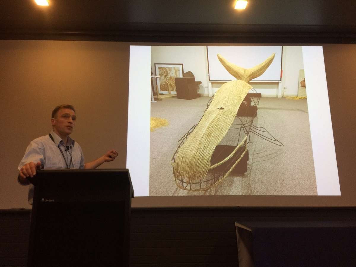 Adam Paterson, Curator at the SA Maritime Museumshows us theframe for a woven whale created by Australian and international Indigenous communities for the exhibition Leviathan. Image: Emily Jateff / ANMM.