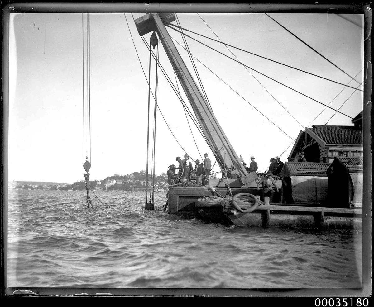 Sheerlegs crane used in the salvaging and recovery efforts. ANMM Collection 00035180, Samuel J Hood Studio.