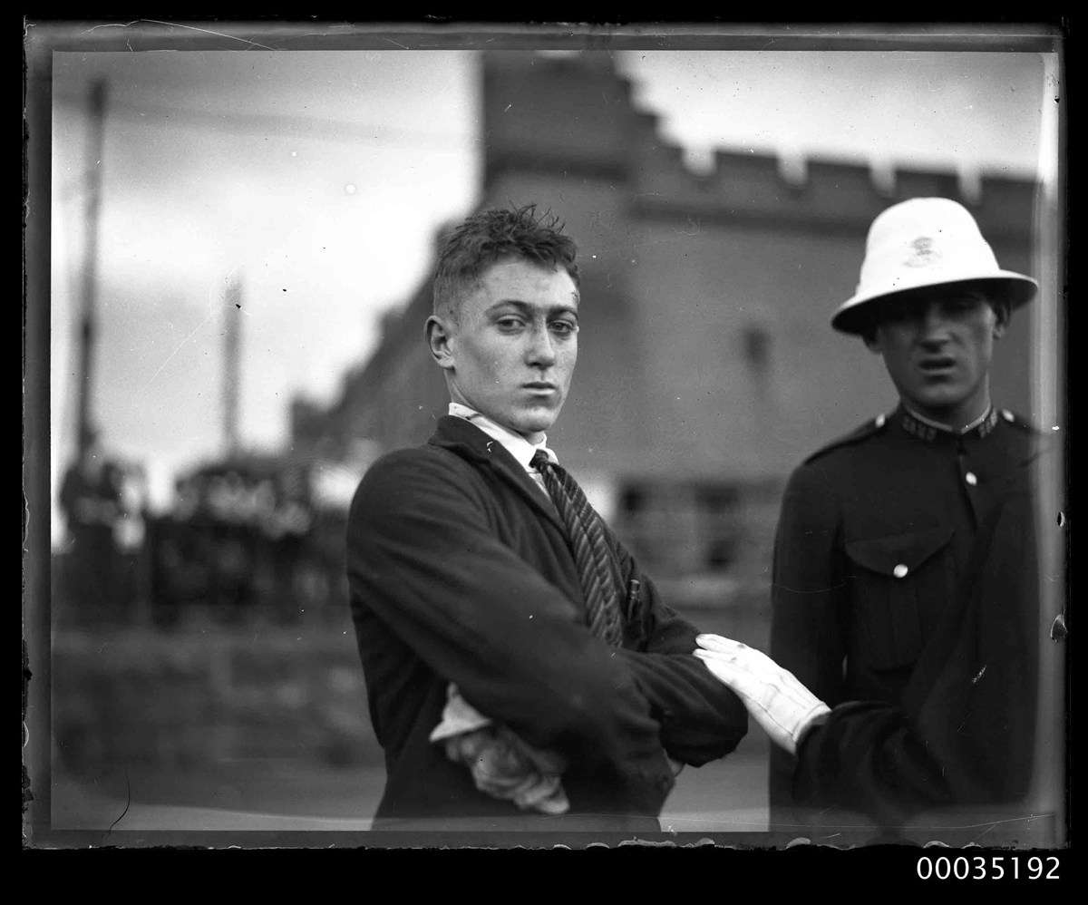 Injured man with a policeman at Fort Macquarie. ANMM Collection 00035192 , Samuel J Hood Studio.
