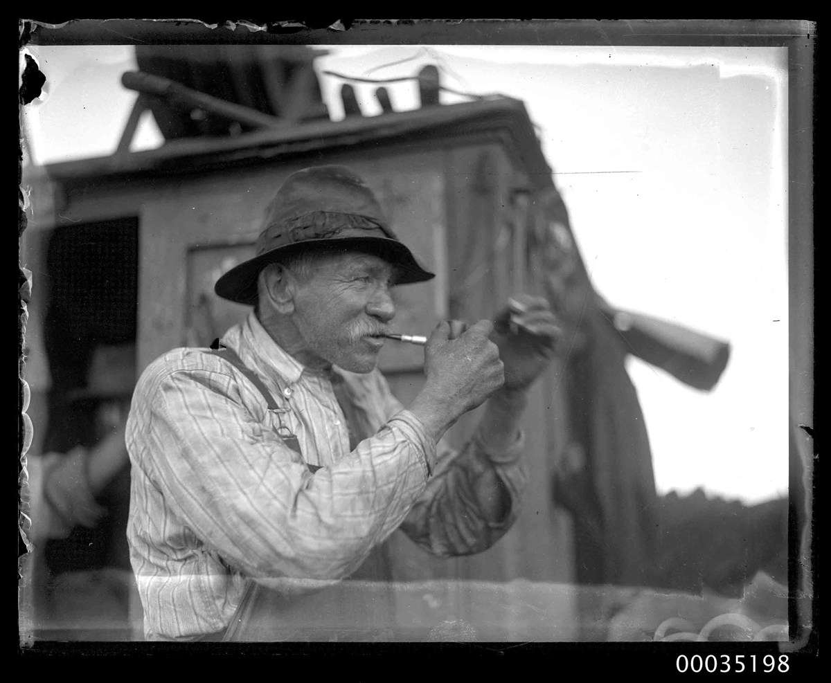 Man in front of a sheerlegs crane, after the Greycliffe disaster. ANMM Collection 00035198, Samuel J Hood Studio.