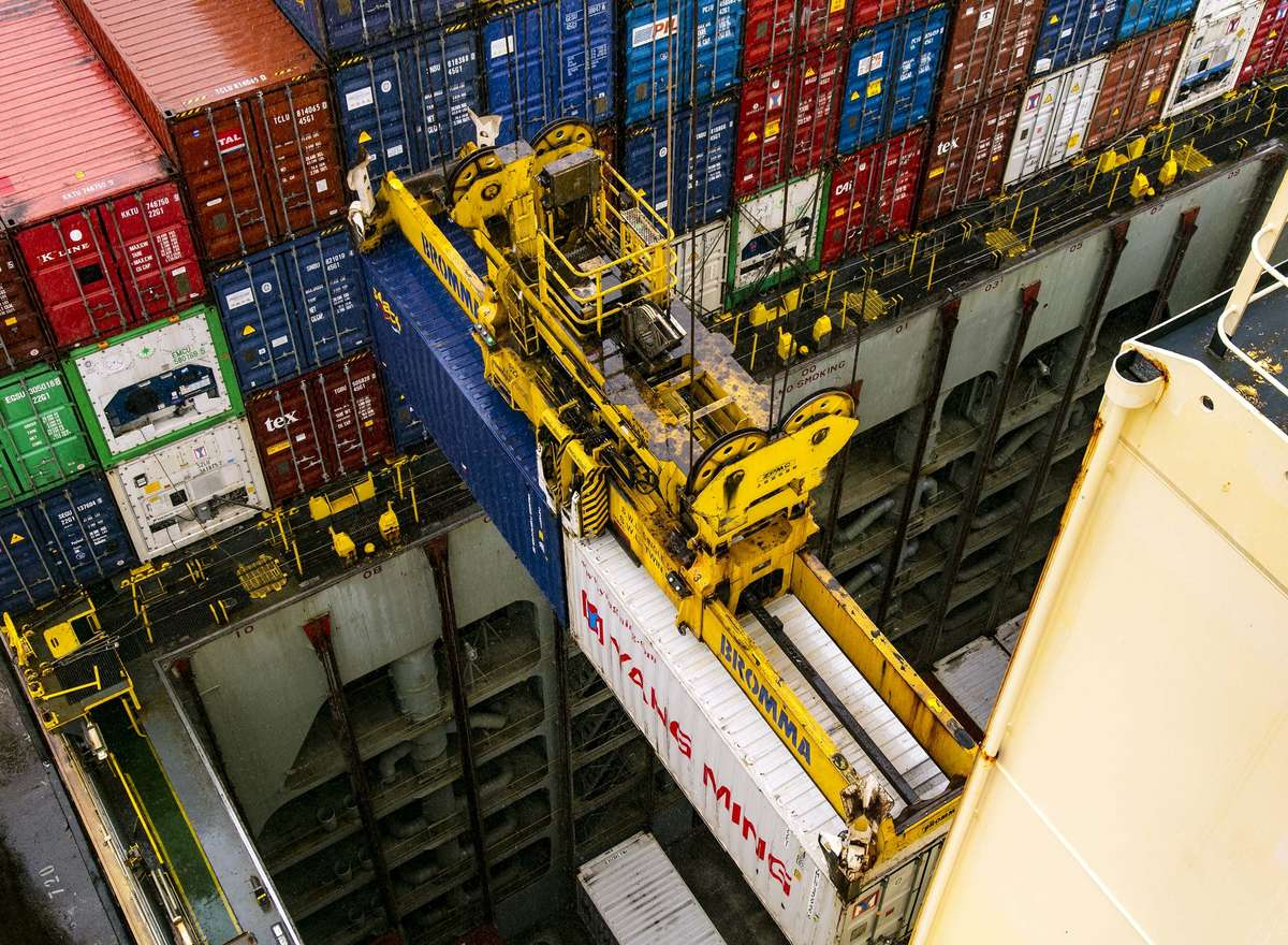 Today 999 boxes are discharged and 932 loaded on a single container ship at Port Botany. The contents of these metal boxes represent millions of dollars worth of trade for Australia. Image: Andrew Frolows/ANMM.