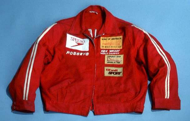 This red cotton drill jacket was worn by Ken Warby when he became the fastest man on water in his hydroplane Spirit of Australia on Blowering Dam near Tumut, New South Wales in 1978. ANMM Collection 0008925.