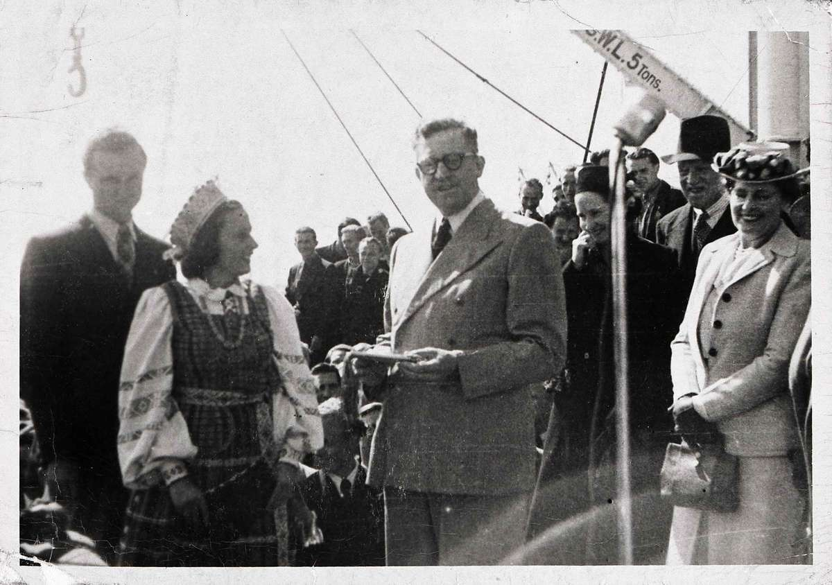 Konstancija Brundzaite presents a gift to Arthur Calwell, Minister for Immigration, 1947. ANMM Collection Gift from the Australian Lithuanian Community 00003844