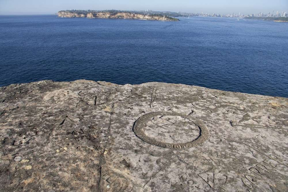 Old Man's Hat, where the 1940 inscription marking the detention of <em>Pierre Loti</em> was carved, offers spectacular views over South Head, the Tasman Sea and hundreds of historic inscriptions left by sailors, passengers and Sydney residents. Image: Ursula K Frederick, Sydney Harbour National Park.