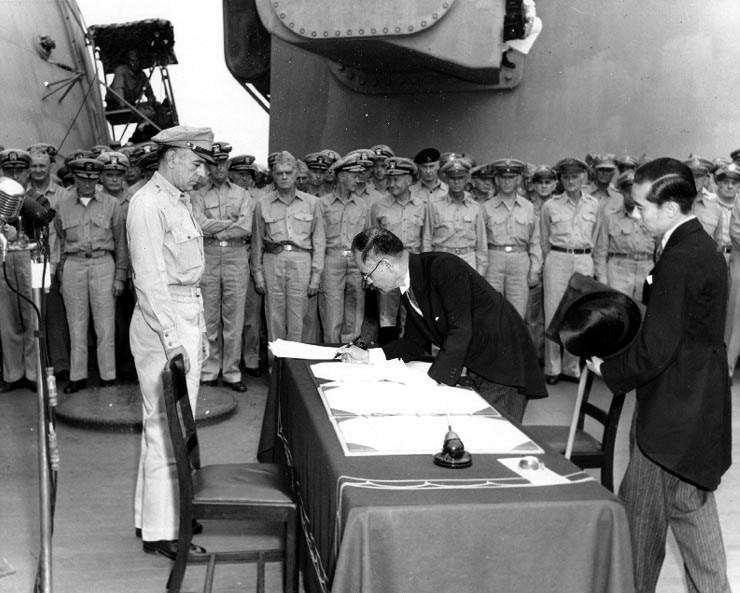 Japanese Foreign Minister Mamoru Shigemitsu signs the Instrument of Surrender on behalf of the Japanese Government, on board USS Missouri (BB-63), 2 September 1945. Image: Naval History and Heritage Command.