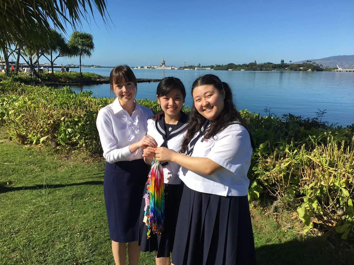 The Japanese students and teacher with the paper cranes they made to be presented to the Museum at the Friendship Ceremony. Image: David Foley / ANMM.