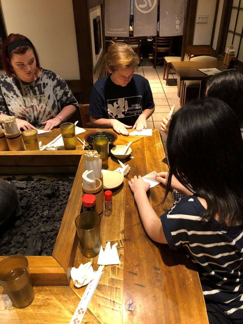 The group making paper cranes at dinner. Image: Jeff Fletcher / ANMM.