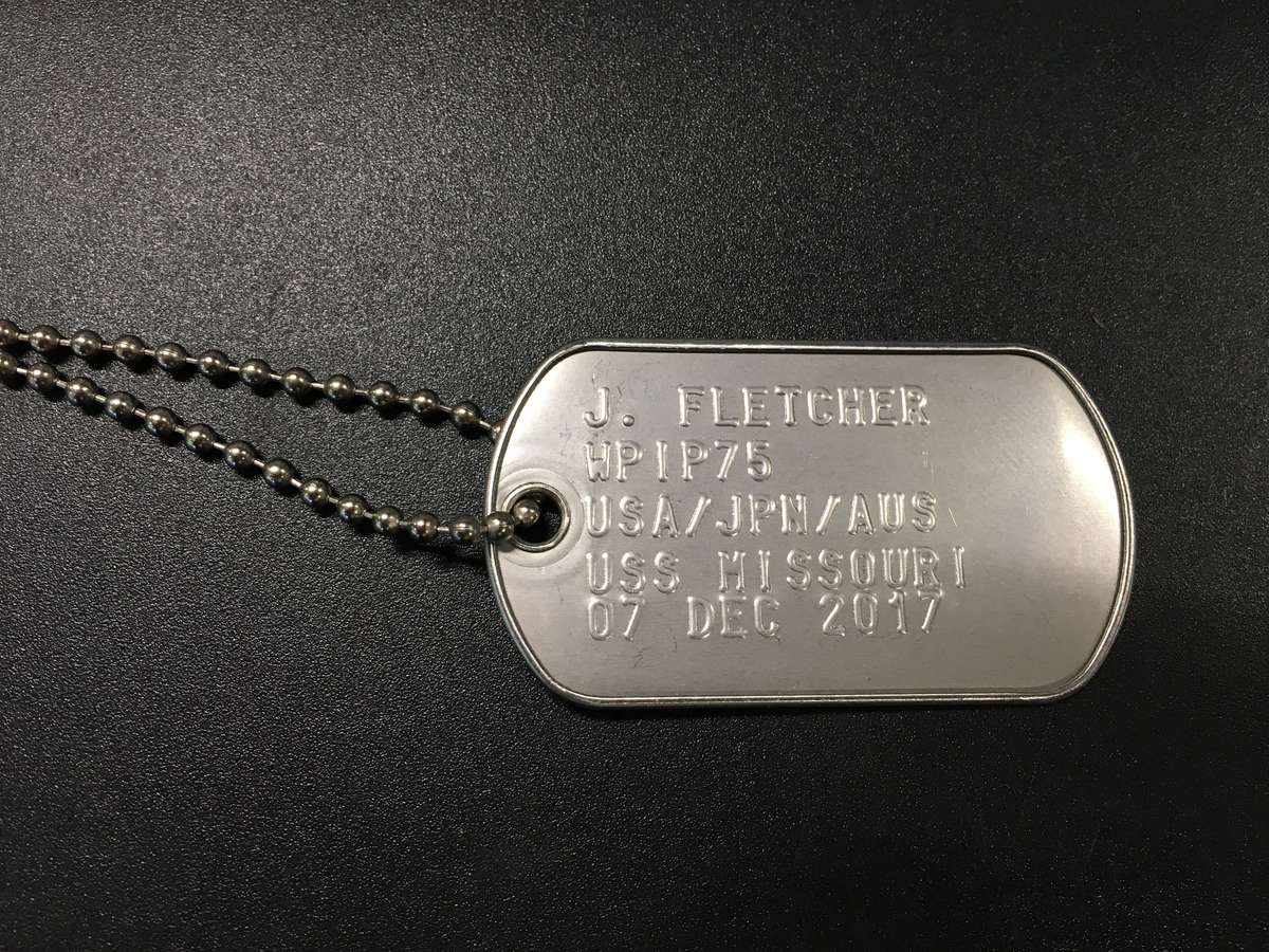 Jeff's dog tag presented by the Learning team of the Battleship Missouri Memorial. Image: Jeff Fletcher / ANMM.