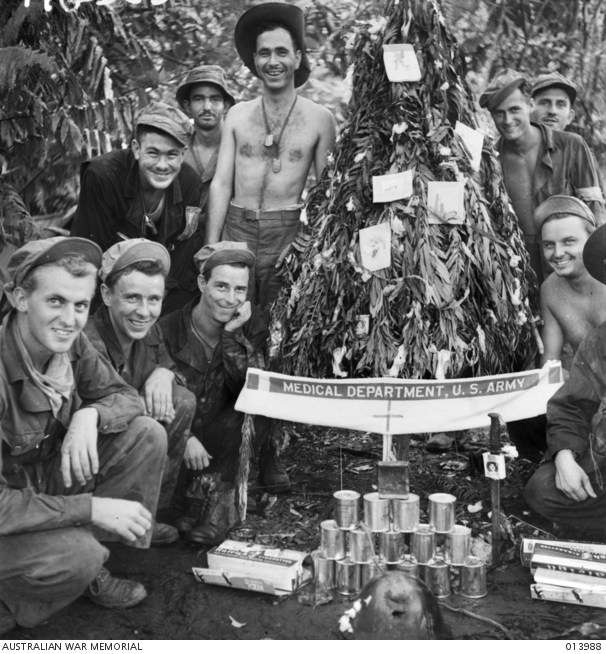 "American soldiers and their improvised Christmas tree. <a href=""https://www.awm.gov.au/index.php/collection/C194485"">AWM Collection</a>."