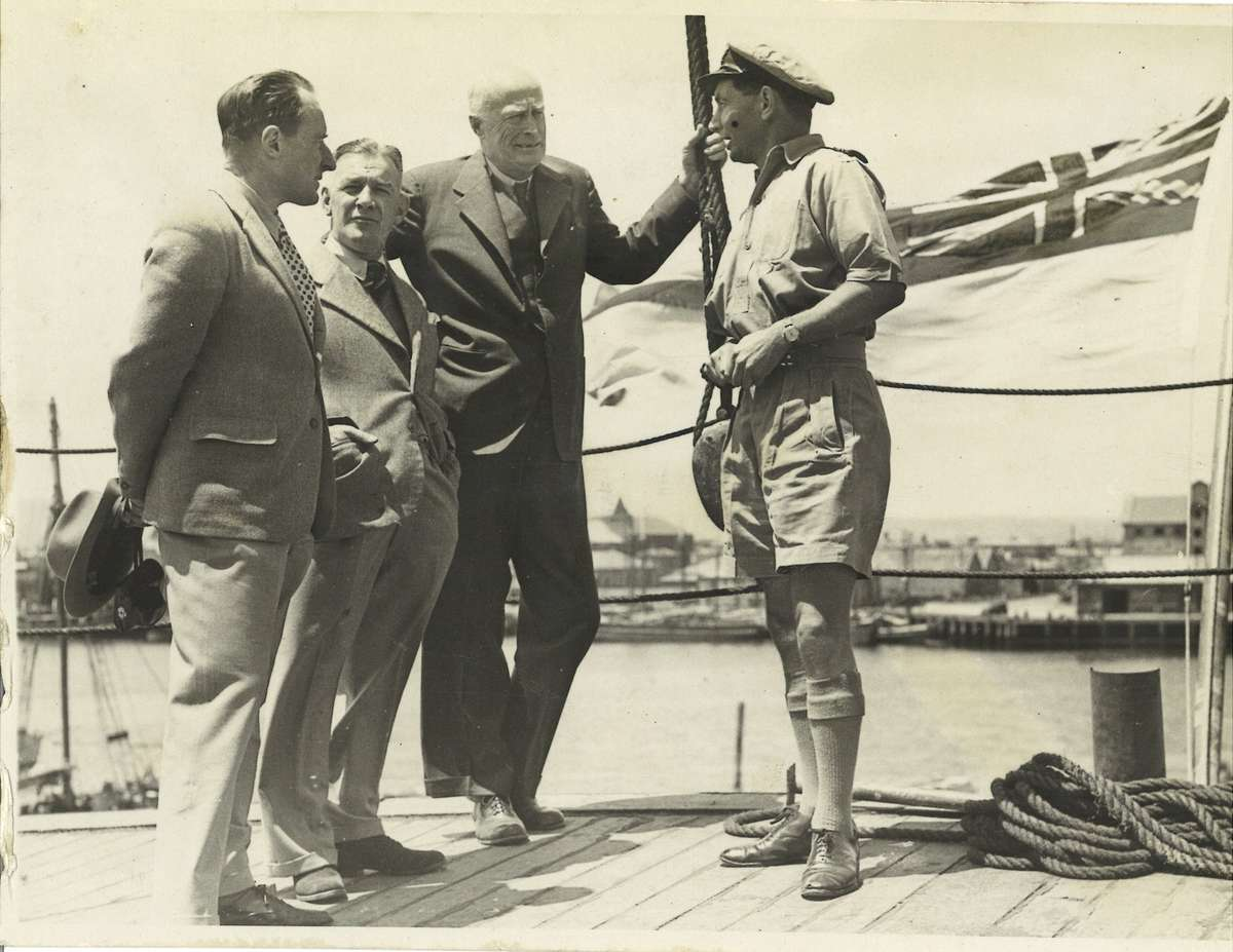 Wyatt Earp's second-in-command, LCDR William Cook (right), confers with visiting dignitaries on the vessel's stern at Williamstown, December 1947. Sir Douglas Mawson stands to Cook's immediate left. ANMM Collection ANMS1445[075].
