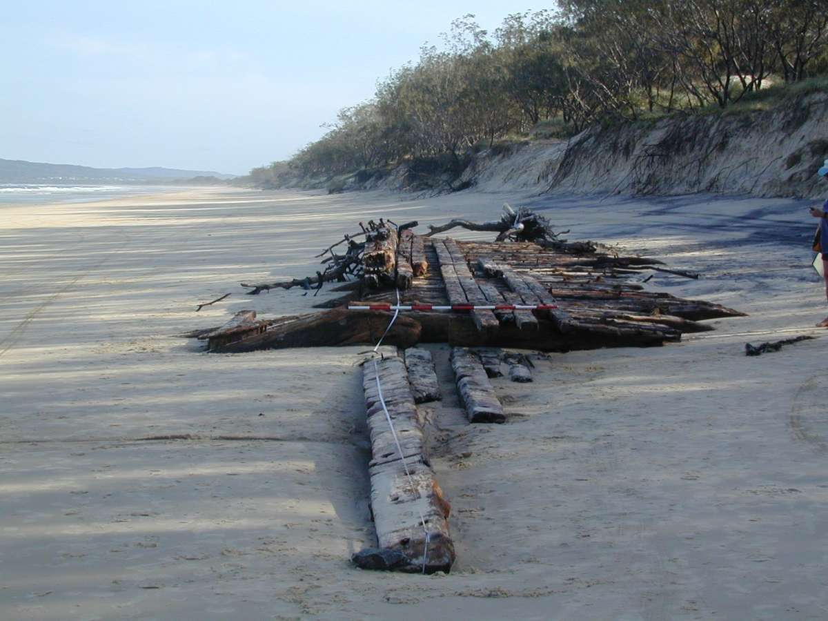 Wooden hull remains believed to be those of MV <em>Natone</em> (ex-<em>Wyatt Earp</em>) at Rainbow Beach, Queensland. Image courtesy Queensland Department of Environment and Heritage Protection.