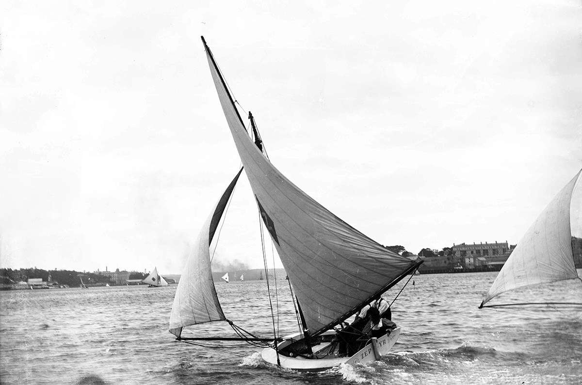 Irene and her brothers Fred and Harry sailing <em>Zephyr</em>. Despite her highly impractical attire, Irene survived two capsizes in one season. Image William James Hall, ANMM Collection 00002619 Gift from Bruce Stannard.