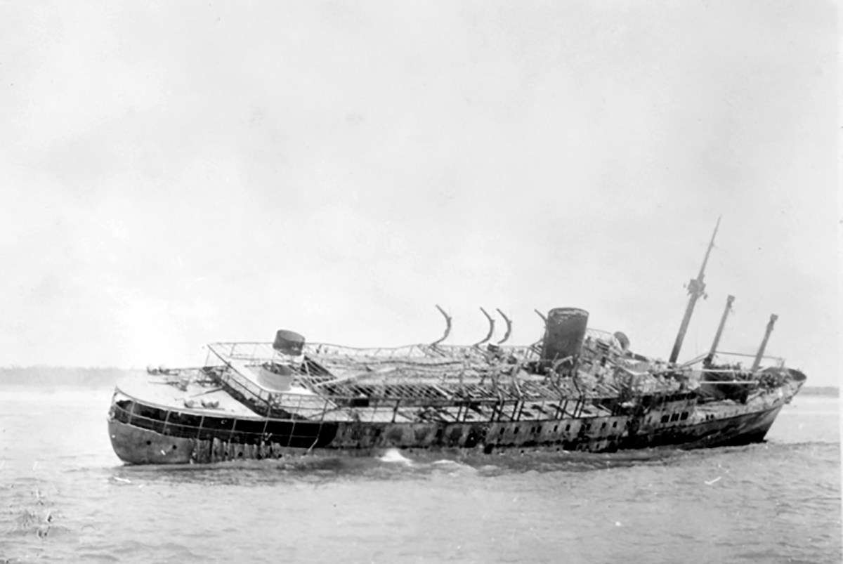 "HMAS <em>Patricia Cam</em> assisted in the salvage of the US Army Transport <em>Don Isidro</em>, which had been attacked by Japanese bombers during the first air raid of Darwin on 19 February 1942. Image: <a herf=""https://www.awm.gov.au/collection/C1151470"">Australian War Memorial</a>."