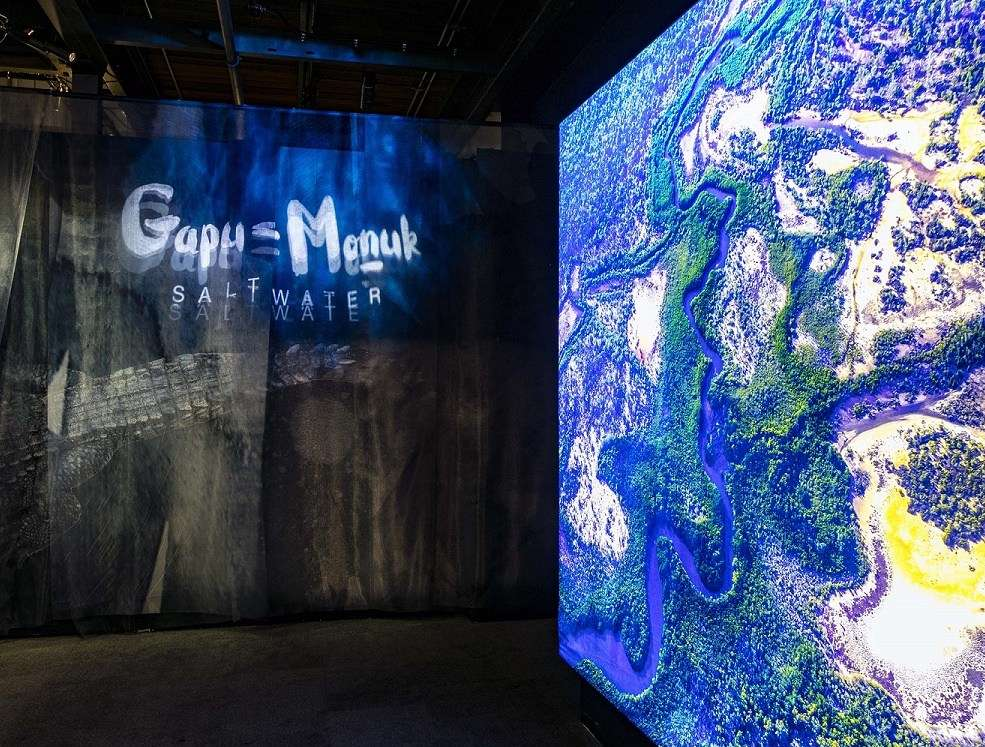 The entrance to the <em>Gapu Monuk Saltwater</em> exhibition, showing the diverse landscape of the Yilpara Saltwater Country, one of the homeland centres of Blue Mud Bay. Image: Andrew Frolows/ANMM.