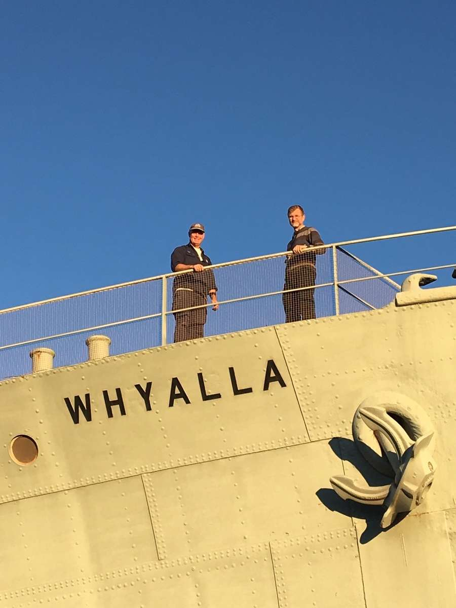 Fleet Manager (right) and Team Leader Steel Vessels (left) onboard HMAS <em>Whyalla</em>, where they offered onsite advice and expertise on the care of the vessel. Image: ANMM.