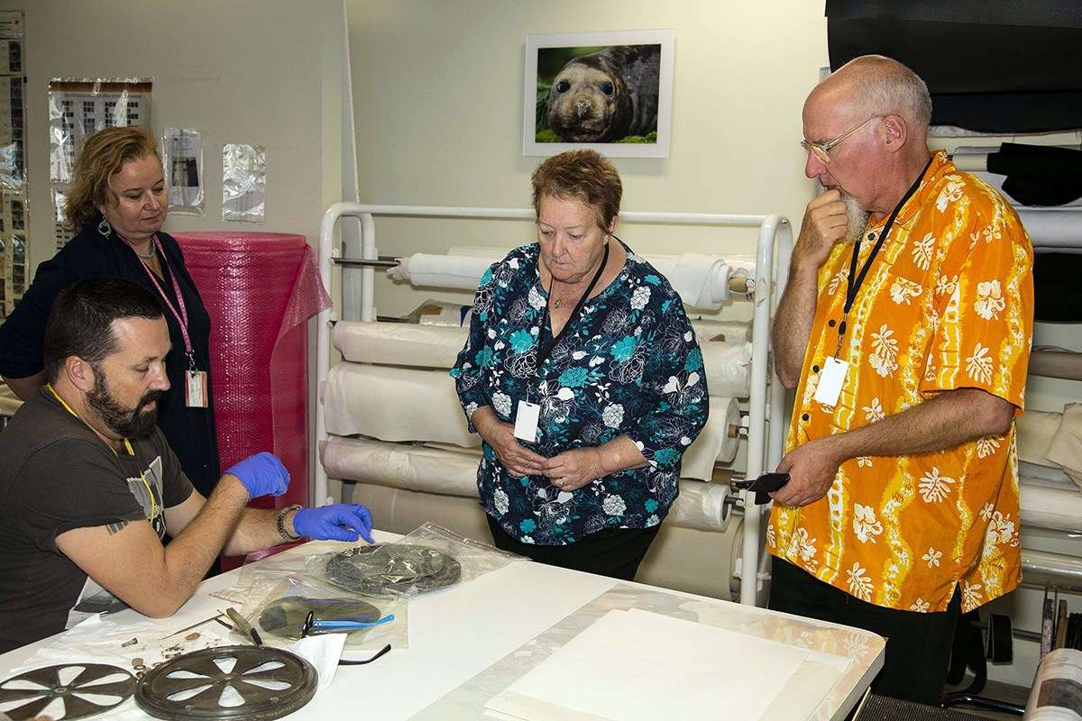 Cathy Mann and Robert van den Helm, with Conservators Jeffrey Fox and Agata Rostek-Robak, in the museum